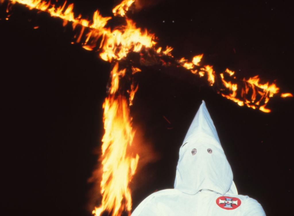 Ku Klux Klansman and a burning cross in Scotland, Connecticut in 1980