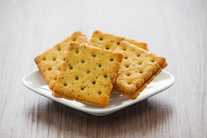 A Plate Of Cracker Biscuit On Wooden Table