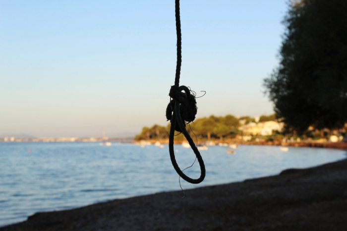 Close-Up Of Silhouette Rope On Beach Against Clear Sky