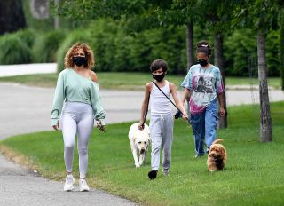 Jennifer Lopez walks dogs with kids Max and Emme in the Hamptons