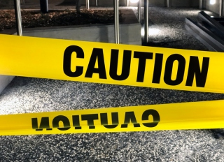 Yellow caution tape closeup, outdoors at night