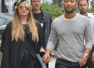 Chrissy Teigen and John Legend step out in Beverly Hills smiling and holding hands