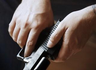 Hands of man holding handgun