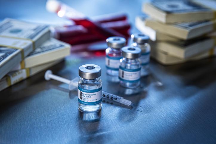 Coronavirus vaccine vials in hospital with money