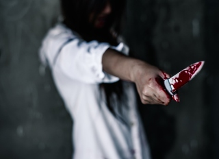 Woman Holding Blood Stain Knife