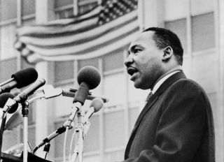 Martin Luther King, Jr., half-length portrait, facing left, speaking at microphones, during anti-war demonstration, New York City, New York, USA, Don Rice for World Journal Tribune, 1967