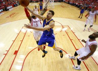 Golden State Warriors' Klay Thompson (11) takes a shot against Houston Rockets' Josh Smith (5) in the second half of Game 4 of the NBA Western Conference finals at the Toyota Center in Houston, Texas, on Monday, May 25, 2015. (Nhat V. Meyer/Bay Area News
