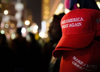 """Make America Great Again"" red baseball caps, signature..."