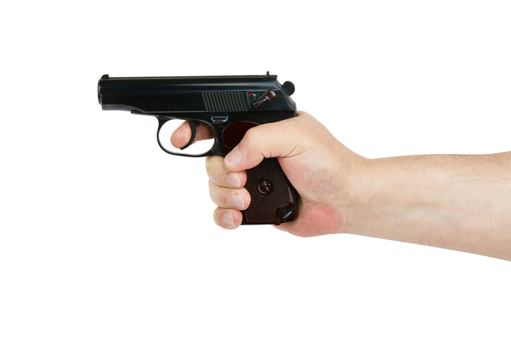 Hand with gun isolated on white background