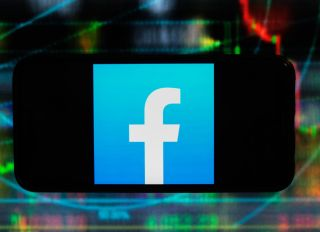 In this photo illustration a Facebook logo is displayed on a...