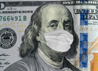 100 dollar banknote with medical mask. World financial crisis concept