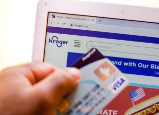 The Kroger Company website is displayed on a laptop in the...