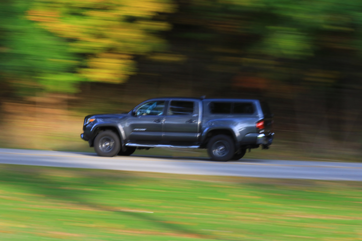 Fast moving Pickup truck on a rural country road