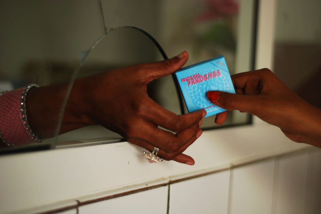 Djibouti, Djibouti city, man buying condom at pharmacy