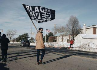 Man Holds Black Lives Matter Flag