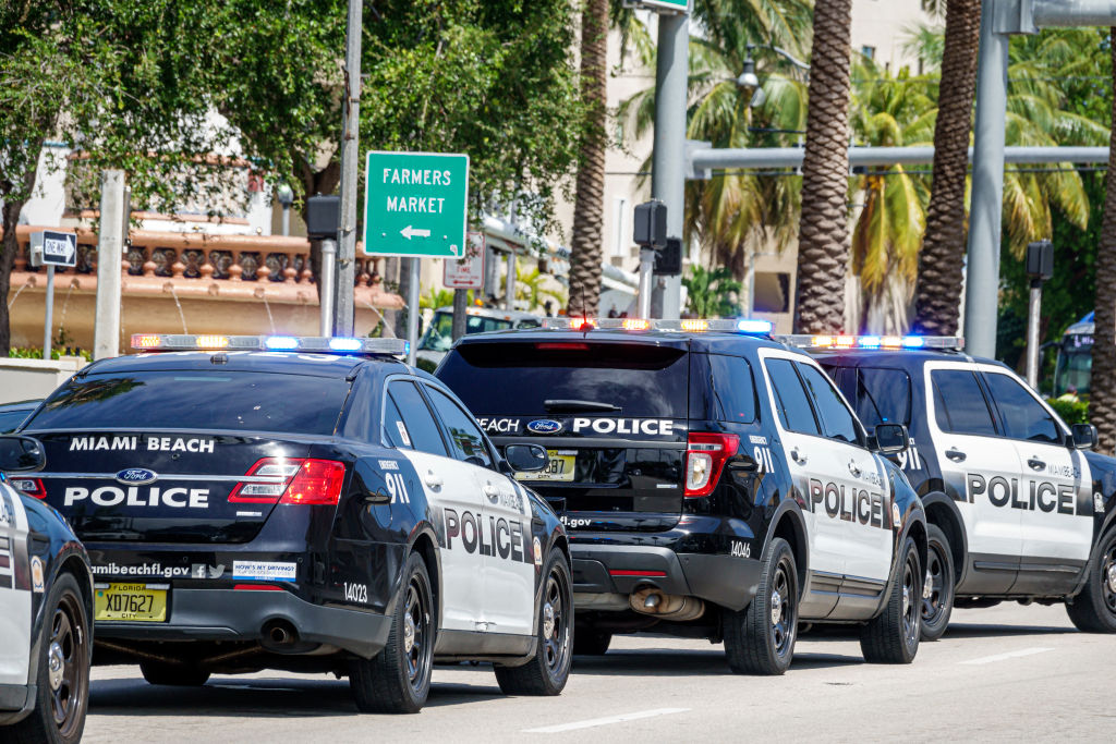 Florida, Miami Beach, police vehicles lined up on street