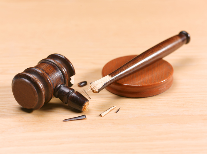 Broken gavel on desk