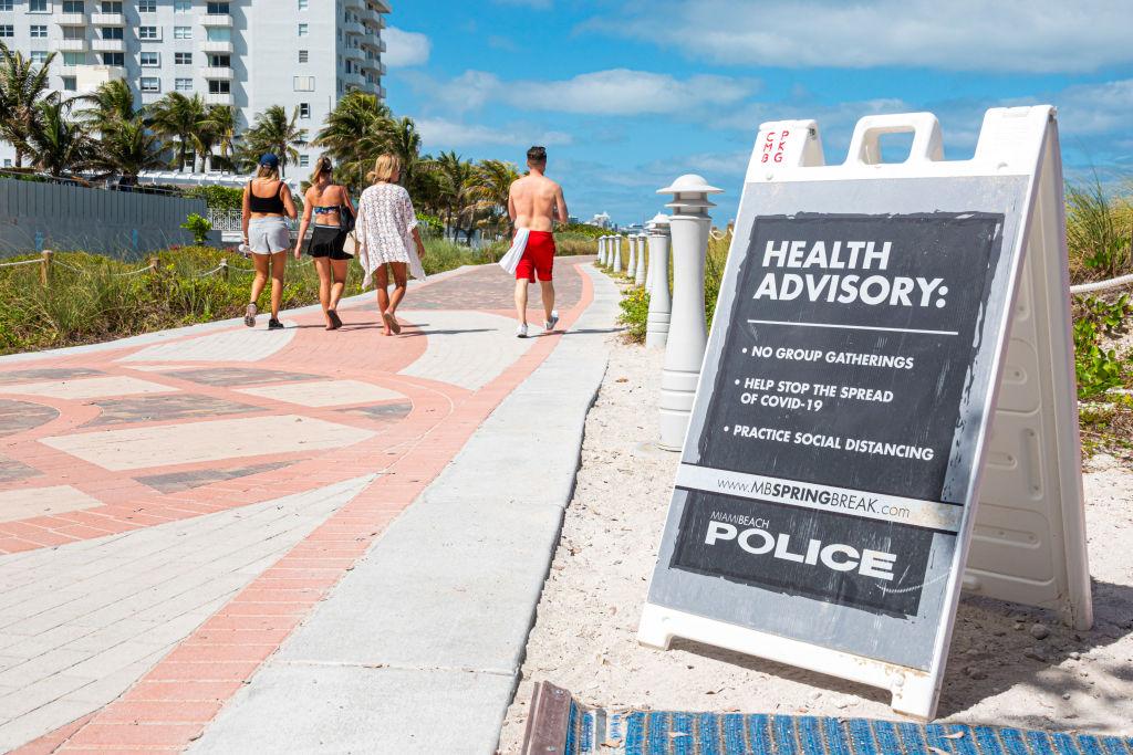 Miami Beach, South Beach, Spring Break closed public beaches sign police warning due to Coronavirus Pandemic