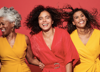 Portrait of a group of mature women against a red background - stock photo