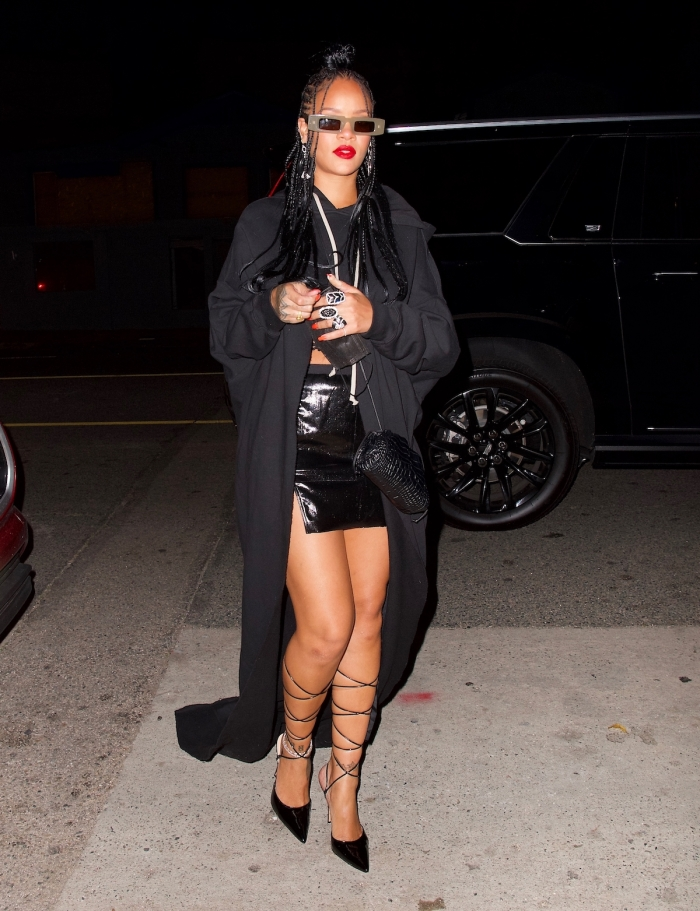 Rihanna wears all black for a night out at Giorgio Baldi