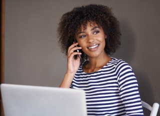 Black woman taking business call