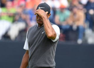 21/07/18 THE 147TH OPEN DAY THREE.CARNOUSTIE .Tiger Woods can't hide his frustration after missing a birdie putt on the 13th .