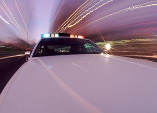 Squad car with siren blaring