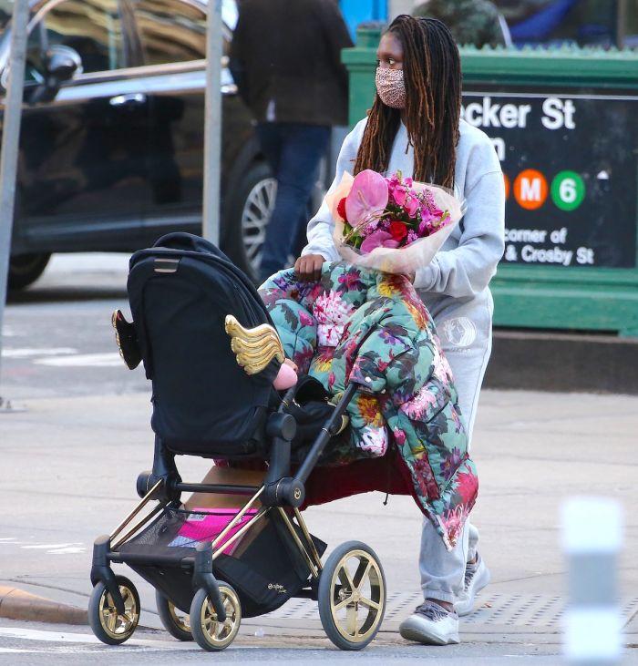 Jodie Turner-Smith walking daughter Janie Jackson in a stroller in Soho
