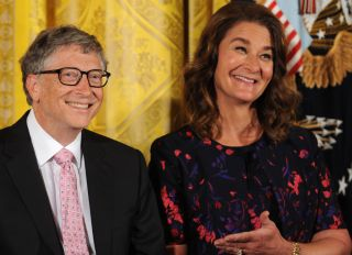 Bill and Melinda Gates react as former U.S. President Barack...