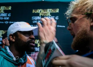 Floyd Mayweather and Jake Paul Face Off