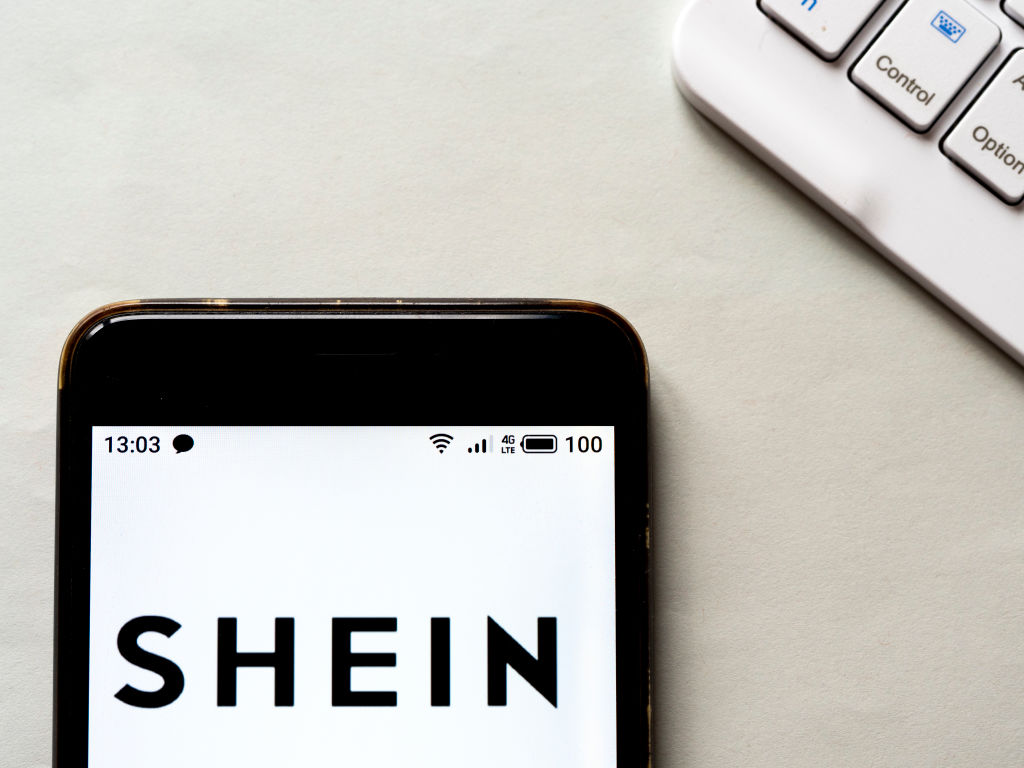 In this photo illustration a Shein logo seen displayed on a...