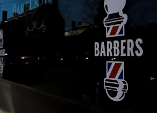 barbershop window front in small town