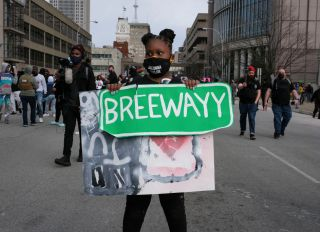 A supporter holds a sign reading Breewayy during a rally