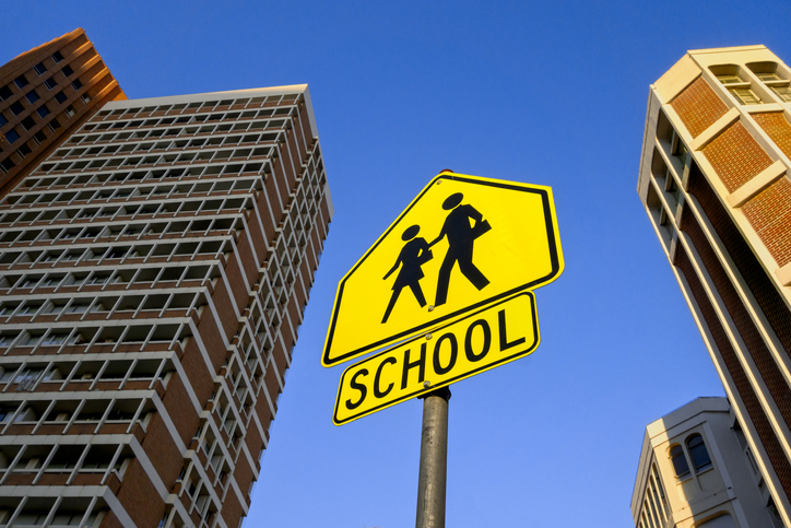 Looking up at School crossing sign