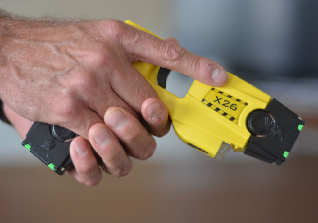 Trooper David Beohm holds his Taser X26 Stun gun. At the State Police Barracks for Troop L. in Reading Tuesday afternoon August 18, 2014, where Trooper David Beohm was showing us his Taser X26 stun gun. Photo by Ben Hasty