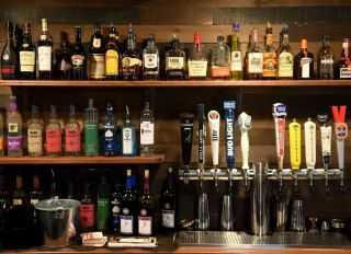 Bottles of liquor and beer taps at the bar. At the Barrel and Ale restaurant and bar in Boyertown Wednesday afternoon October 2, 2019. Photo by Ben Hasty