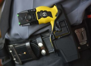 A detail photo of a Taser X26 stun gun in the holster. At the State Police Barracks for Troop L. in Reading Tuesday afternoon August 18, 2014, where Trooper David Beohm was showing us his Taser X26 stun gun. Photo by Ben Hasty
