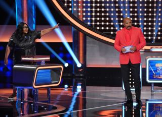 Celebrity Family Feud episodic still featuring Loni Love and Steve Harvey