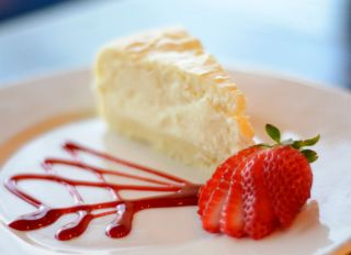Whipped cream cheese cheesecake with a shortbread crust and strawberry from Say Cheese in West Reading.Plating plays a big role in the presentation of a dish. For Life story. Photo by Jeremy Drey 2/26/2014