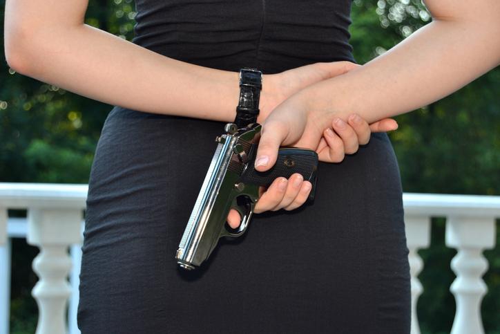 The gun behind