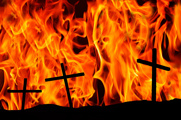 Three christian crosses on the background of the flame. Religion concept