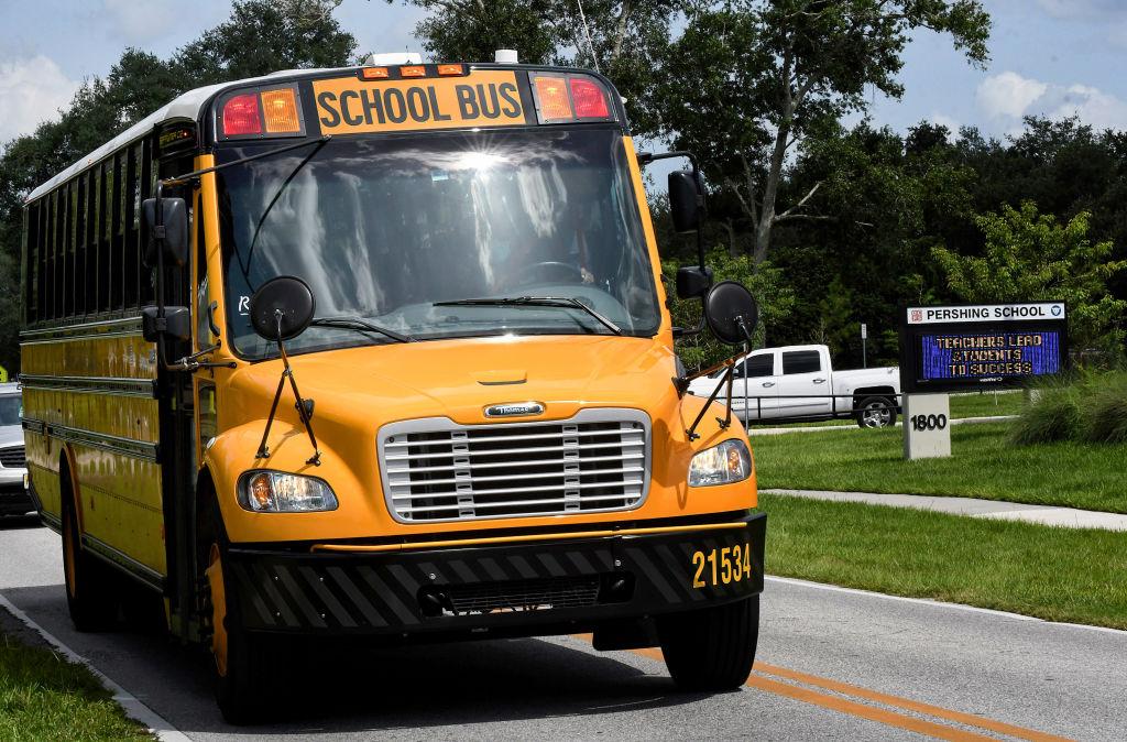 A school bus drives past Pershing School in Orlando.