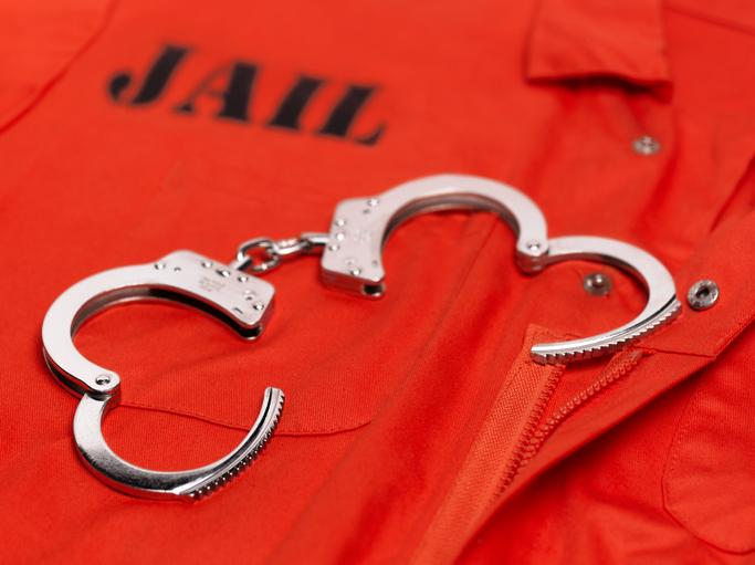 Orange prisoner's jumpsuit, with handcuffs