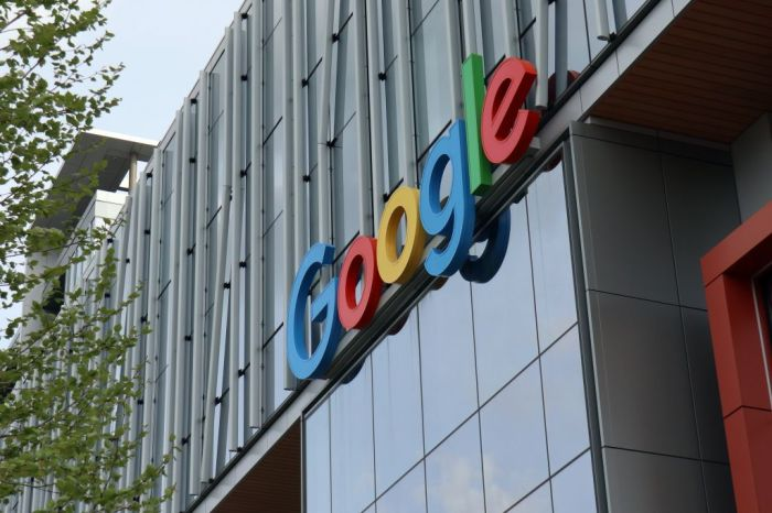 The Google logo seen at the entrance to Google Cloud campus...