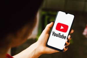 In this photo illustration the YouTube logo seen displayed...